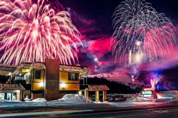Rabbit Ears Motel with fireworks exploding behind