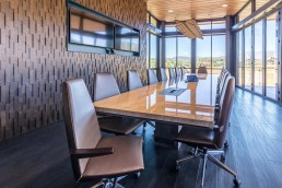 modern conference table with mountain view out big windows