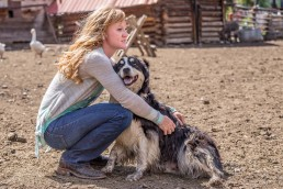 girl and her dog on ranch